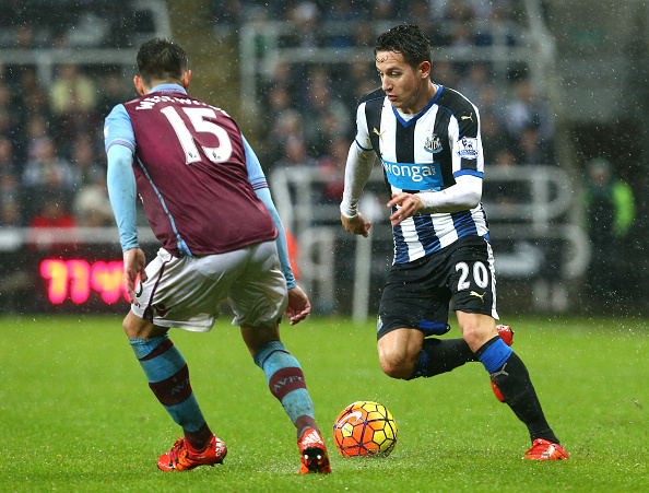 NEWCASTLE UPON TYNE, ENGLAND - DECEMBER 19 :  Florian Thauvin of Newcastle is challenged by Ashley Westwood of Aston Villa during the Barclays Premier League match between Newcastle United FC and Aston Villa FC at St James' Park on December 19, 2015 in Newcastle Upon Tyne, England. (Photo by Mark Runnacles/Getty Images)