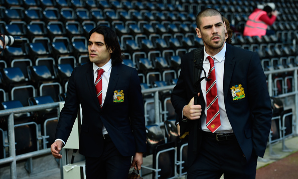SWANSEA, WALES - FEBRUARY 21:  Manchester United players Radamel Falcao (l) and Victor Valdes arrive at the stadium before the Barclays Premier League match between Swansea City and Manchester United at Liberty Stadium on February 21, 2015 in Swansea, Wales.  (Photo by Stu Forster/Getty Images)