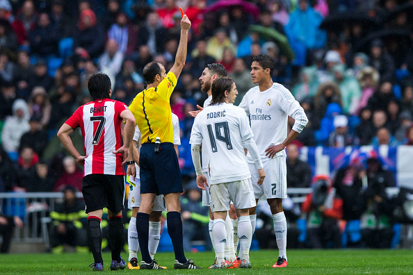 MADRID, SPAIN - FEBRUARY 13:  Referee Alfonso Javier Alvarez Izquierdo (2ndL) shows the red card to Raphael Varane (R) during the La Liga match between Real Madrid CF and Athletic Club at Estadio Santiago Bernabeu on February 13, 2016 in Madrid, Spain.  (Photo by Gonzalo Arroyo Moreno/Getty Images)