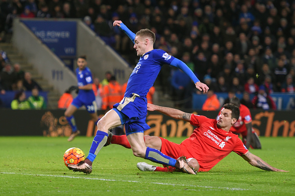LEICESTER, ENGLAND - FEBRUARY 02: Jamie Vardy of Leicester City scores his team's second goal while Dejan Lovren of Liverpool tries to block during the Barclays Premier League match between Leicester City and Liverpool at The King Power Stadium on February 2, 2016 in Leicester, England.  (Photo by Michael Regan/Getty Images)
