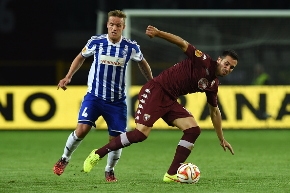 TURIN, ITALY - OCTOBER 23:  Nikola Maksimovic (R) of Torino FC is challenged by Mika Vayrynen of HJK Helsinki during the UEFA Europa League group B match between Torino FC and HJK Helsinki at Olimpico stadium on October 23, 2014 in Turin, Italy.  (Photo by Valerio Pennicino/Getty Images)