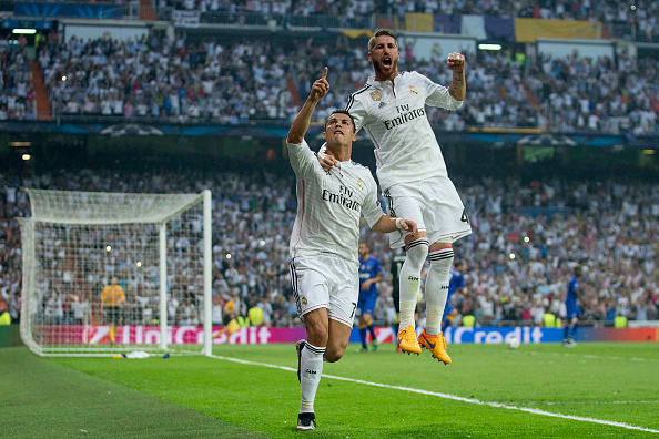 MADRID, SPAIN - MAY 13:  Cristiano Ronaldo (L) of Real Madrid CF celebrates scoring their opening goal with teammate Sergio Ramos (L) during the UEFA Champions League semi-final second leg match between Real Madrid CF and Juventus at Estadio Santiago Bernabeu on May 13, 2015 in Madrid, Spain.  (Photo by Gonzalo Arroyo Moreno/Getty Images)