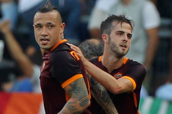 ROME, ITALY - AUGUST 30:  Miralem Pjanic (R) with his teammate Radja Nainggolan of AS Roma celebrates after scoring the opening goal during the Serie A match between AS Roma and Juventus FC at Stadio Olimpico on August 30, 2015 in Rome, Italy.  (Photo by Paolo Bruno/Getty Images)