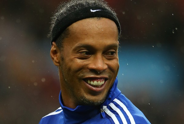 MANCHESTER, ENGLAND - NOVEMBER 14:  Ronaldinho Gaucho of the Rest of the World warms up prior to kickoff during the David Beckham Match for Children in aid of UNICEF between Great Britain & Ireland and Rest of the World at Old Trafford on November 14, 2015 in Manchester, England.  (Photo by Alex Livesey/Getty Images)
