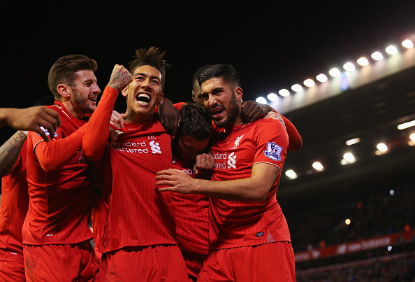 LIVERPOOL, ENGLAND - NOVEMBER 29:  James Milner of Liverpool (2R) is congratulated by Adam Lallana (L), Roberto Firmino (2L), Emre Can (R) as he scores their first goal from a penalty during the Barclays Premier League match between Liverpool and Swansea City at Anfield on November 29, 2015 in Liverpool, England.  (Photo by Alex Livesey/Getty Images)