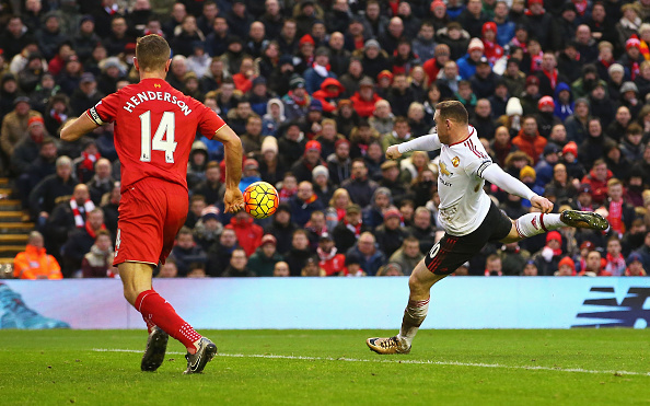 LIVERPOOL, ENGLAND - JANUARY 17:  Wayne Rooney of Manchester United scores the opening goal during the Barclays Premier League match between Liverpool and Manchester United at Anfield on January 17, 2016 in Liverpool, England.  (Photo by Alex Livesey/Getty Images)