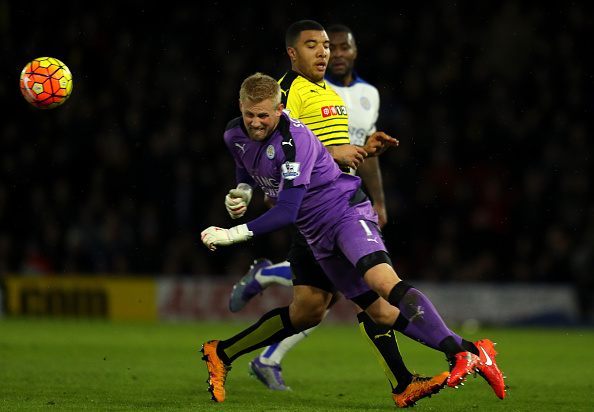 WATFORD, ENGLAND - MARCH 05:  Kasper Schmeichel of Leicester saves from Troy Deeney of Watford during the Barclays Premier League match between Watford and Leicester City at Vicarage Road on March 5, 2016 in Watford, England.  (Photo by Richard Heathcote/Getty Images)