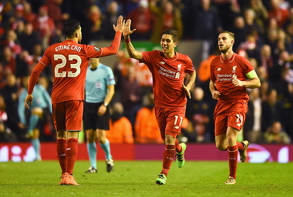 LIVERPOOL, ENGLAND - MARCH 10:  Roberto Firmino of Liverpool (11) celebrates with Emre Can (23) as he scores their second goal during the UEFA Europa League Round of 16 first leg match between Liverpool and Manchester United at Anfield on March 10, 2016 in Liverpool, United Kingdom.  (Photo by Laurence Griffiths/Getty Images)