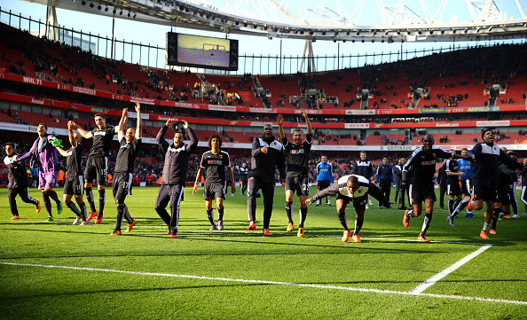 LONDON, ENGLAND - MARCH 13:  Watford players celebrate victory after the Emirates FA Cup sixth round match between Arsenal and Watford at Emirates Stadium on March 13, 2016 in London, England.  (Photo by Richard Heathcote/Getty Images)