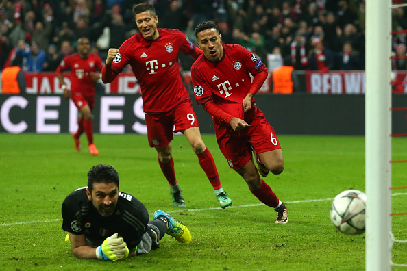 MUNICH, GERMANY - MARCH 16:  Thiago Alcantara (R) of Bayern Muenchen celebrates scoring his team's third goal past Gianluigi Buffon (L) of Juventus during the UEFA Champions League round of 16, second Leg match between FC Bayern Muenchen and Juventus at the Allianz Arena on March 16, 2016 in Munich, Germany.  (Photo by Alexander Hassenstein/Bongarts/Getty Images)