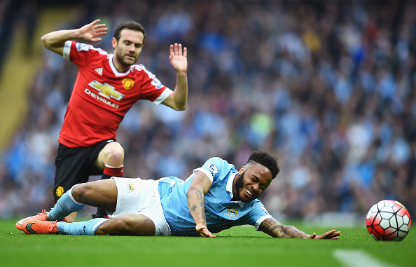 MANCHESTER, ENGLAND - MARCH 20:  Raheem Sterling of Manchester City is challenged by Juan Mata of Manchester United during the Barclays Premier League match between Manchester City and Manchester United at Etihad Stadium on March 20, 2016 in Manchester, United Kingdom.  (Photo by Laurence Griffiths/Getty Images)