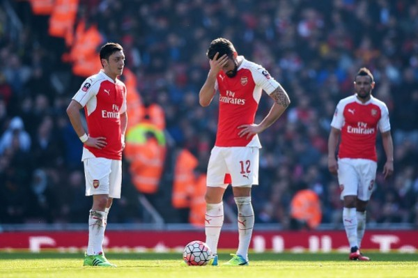 LONDON, ENGLAND - MARCH 13:  Olivier Giroud (12) and Mesut Ozil (11) of Arsenal look dejected as Adlene Guedioura of Watford scores their second goal during the Emirates FA Cup sixth round match between Arsenal and Watford at Emirates Stadium on March 13, 2016 in London, England.  (Photo by Shaun Botterill/Getty Images)
