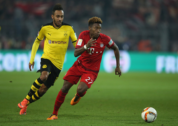 DORTMUND, GERMANY - MARCH 05: David Alaba of Bayern Munich and Pierre-Emerick Aubameyang of Borussia Dortmund compete for the ball during the Bundesliga match between Borussia Dortmund and FC Bayern Muenchen at Signal Iduna Park on March 5, 2016 in Dortmund, Germany.  (Photo by Lars Baron/Bongarts/Getty Images)