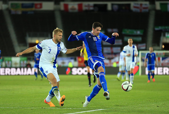 HELSINKI, FINLAND - OCTOBER 11:  Paulus Arajuuri of Finland and Kyle Lafferty of Northern Ireland compete for the ball during the UEFA EURO 2016 Qualifying match between Finland and Northern Ireland at the Olympic Stadium on October 11, 2015 in Helsinki, Finland. (Photo by Stephen Pond/Getty Images)