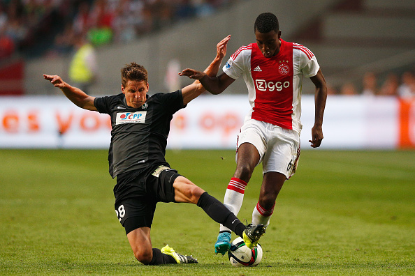 AMSTERDAM, NETHERLANDS - AUGUST 20:  Lukas Masopust of FK Baumit Jablonec tackles Riechedly Bazoer of Ajax during the UEFA Europa League play off round 1st leg match between Ajax Amsterdam and FK Baumit Jablonec on August 20, 2015 in Amsterdam, Netherlands.  (Photo by Dean Mouhtaropoulos/Getty Images)