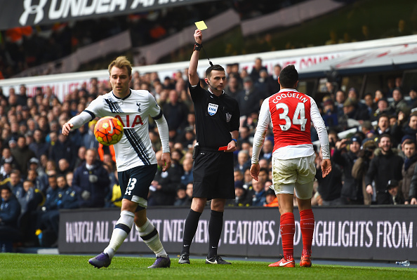LONDON, ENGLAND - MARCH 05:  Francis Coquelin (R) of Arsenal is shown the second yellow card resulting in sending off by referee Michael Oliver (C)  during the Barclays Premier League match between Tottenham Hotspur and Arsenal at White Hart Lane on March 5, 2016 in London, England.  (Photo by Shaun Botterill/Getty Images)