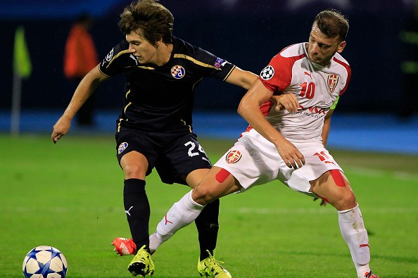 ZAGREB, CROATIA - AUGUST 25.  Ante Coric (L) of Dinamo Zagreb is challenged by Bledi Shkembi (R) of KF Skenderbeu during the UEFA Champions League Qualifying Round Play Off Second Leg match between Dinamo Zagreb and FC Skenderbeu at Maksimir Stadium on August 25, 2015 in Zagreb, Croatia. (Photo by Srdjan Stevanovic/Getty Images)