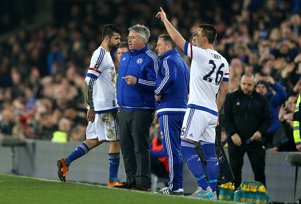 LIVERPOOL, ENGLAND - MARCH 12:  Diego Costa (1st L) of Chelsea walks off the pitch past Guus Hiddink (2nd L) interim manager of Chelsea after the red card during the Emirates FA Cup sixth round match between Everton and Chelsea at Goodison Park on March 12, 2016 in Liverpool, England.  (Photo by Chris Brunskill/Getty Images)