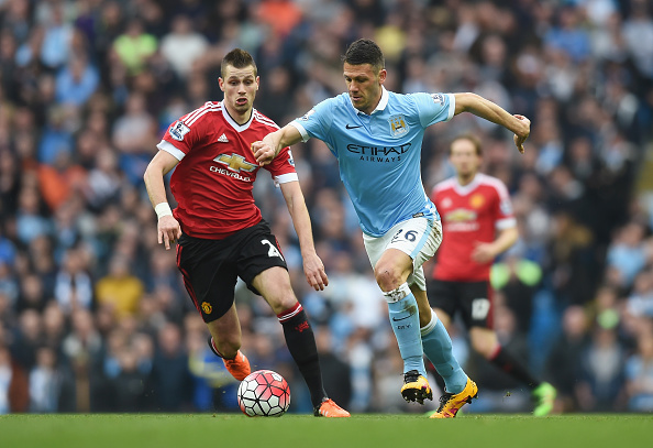 MANCHESTER, ENGLAND - MARCH 20:  Martin Demichelis of Manchester City takes on Morgan Schneiderlin of Manchester United during the Barclays Premier League match between Manchester City and Manchester United at Etihad Stadium on March 20, 2016 in Manchester, United Kingdom.  (Photo by Michael Regan/Getty Images)