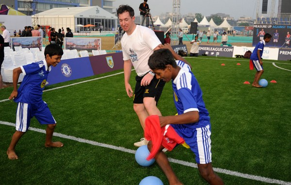 MUMBAI, INDIA - DECEMBER 12: Robbie Fowler, Liverpool legend plays with the kids from Magic bus during the Barclays Premier League 'Live' event  on December 12, 2014 in Mumbai, India. (Photo by Pal Pillai/Getty Images for Premier League)