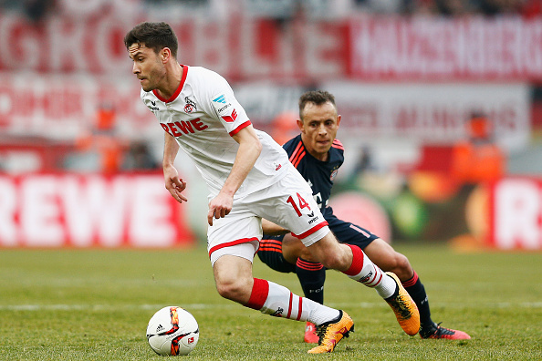 COLOGNE, GERMANY - MARCH 19:  Jonas Hector of koeln gets past the tackle from Rafinha of Bayern Muenchen during the Bundesliga match between 1. FC Koeln and FC Bayern Muenchen held at RheinEnergieStadion on March 19, 2016 in Cologne, Germany.  (Photo by Dean Mouhtaropoulos/Bongarts/Getty Images)