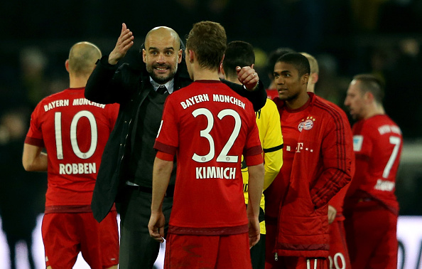 DORTMUND, GERMANY - MARCH 05:  Josep Guardiola manager of Bayern Munich talks to Joshua Kimmich after the Bundesliga match between Borussia Dortmund and FC Bayern Muenchen at Signal Iduna Park on March 5, 2016 in Dortmund, Germany.  (Photo by Lars Baron/Bongarts/Getty Images)