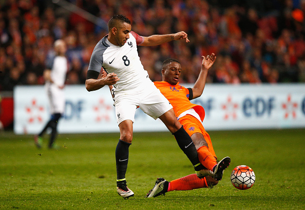 AMSTERDAM, NETHERLANDS - MARCH 25:  Dimitri Payet of France is challenged by Riechedly Bazoer of the Netherlands during the International Friendly match between Netherlands and France at Amsterdam Arena on March 25, 2016 in Amsterdam, Netherlands.  (Photo by Dean Mouhtaropoulos/Getty Images)