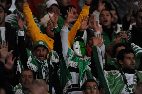 MARRAKECH, MOROCCO - DECEMBER 21: Raja Casablanca fans enjoy the atmosphere before the FIFA Club World Cup Final match between FC Bayern Munchen v Raja Casablanca at Marrakech Stadium on December 21, 2013 in Marrakech, Morocco.  (Photo by Steve Bardens/Getty Images)
