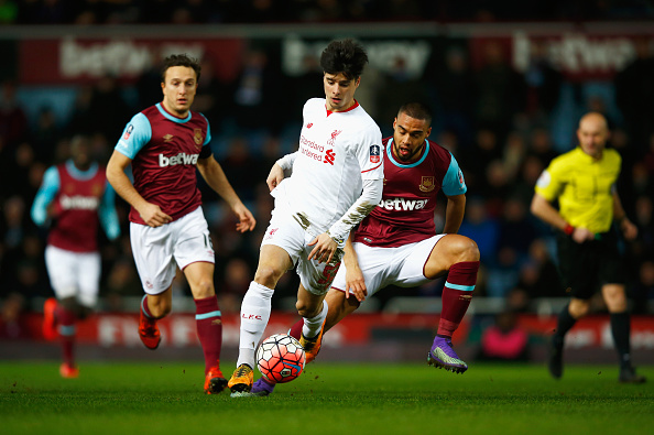 LONDON, ENGLAND - FEBRUARY 09:  Joao Carlos Teixeira of Liverpool evades Mark Noble (L) and Winston Reid of West Ham United during the Emirates FA Cup Fourth Round Replay match between West Ham United and Liverpool at Boleyn Ground on February 9, 2016 in London, England.  (Photo by Clive Rose/Getty Images)
