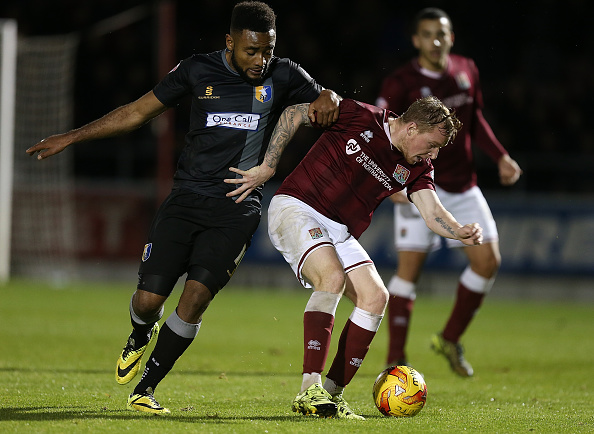 NORTHAMPTON, ENGLAND - NOVEMBER 14:  Nicky Adams of Northampton Town contests the ball with Adi Yussuf of Mansfield Town during the Sky Bet League Two match between Northampton Town and Mansfield Town at Sixfields Stadium on November 14, 2015 in Northampton, England.  (Photo by Pete Norton/Getty Images)