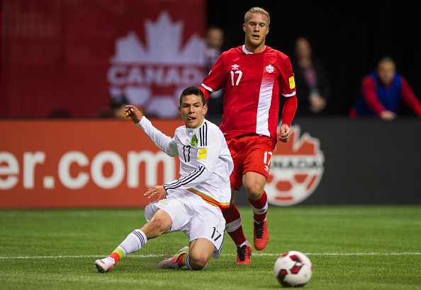 VANCOUVER, BC - MARCH 25:  Hirving Lozano #17 of Mexico crosses the ball after getting past Marcel De Jong #17 of Canada during FIFA 2018 World Cup Qualifier soccer action at BC Place on March 25, 2016 in Vancouver, Canada. (Photo by Rich Lam/Getty Images)