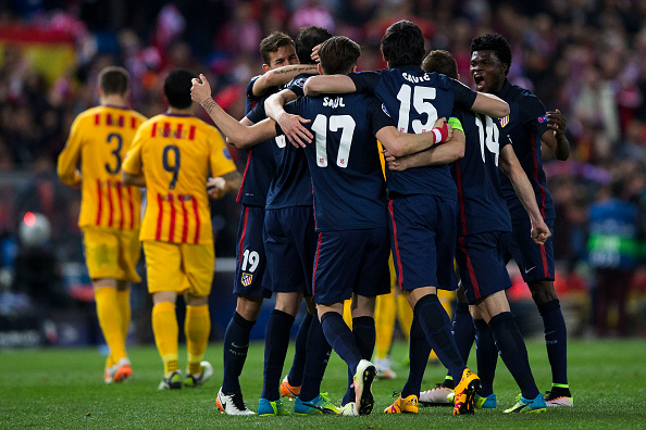 MADRID, SPAIN - APRIL 13:  Atletico de Madrid players celebrate their victory ahead FC Barcelona ones after the UEFA Champions League quarter final, second leg match between Club Atletico de Madrid and FC Barcelona at the Vincente Calderon on April 13, 2016 in Madrid, Spain.  (Photo by Gonzalo Arroyo Moreno/Getty Images)