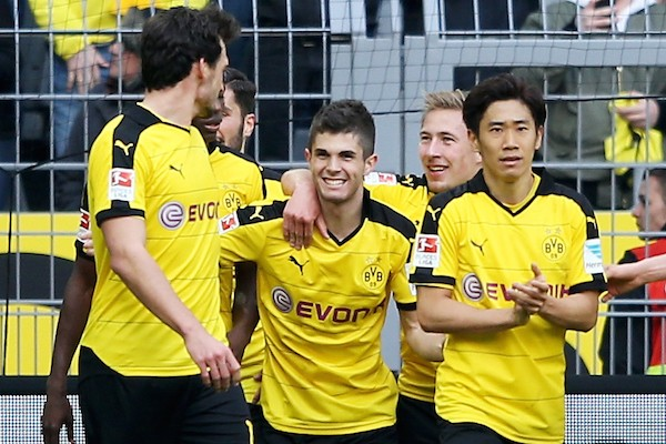 DORTMUND, GERMANY - APRIL 17: Christian Pulisic of Dortmund celebrates with team mates after scoring his teams first goal during the Bundesliga match between Borussia Dortmund and Hamburger SV at Signal Iduna Park on April 17, 2016 in Dortmund, Germany.  (Photo by Lars Baron/Bongarts/Getty Images)