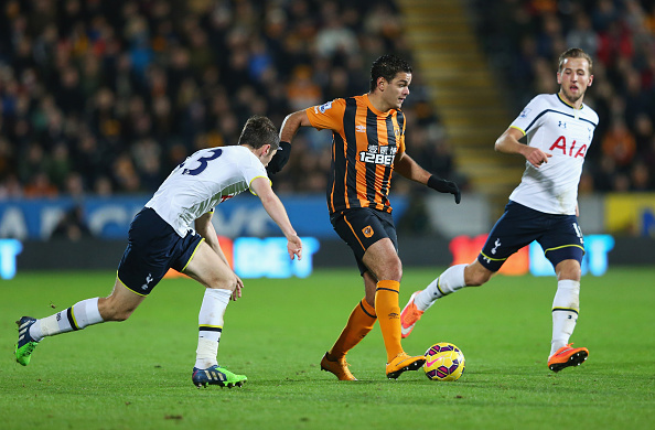HULL, ENGLAND - NOVEMBER 23:  Hatem Ben Arfa of Hull City takes on Harry Kane of Tottenham Hotspur (R) during the Barclays Premier League match between Hull City and Tottenham Hotspur at KC Stadium on November 23, 2014 in Hull, England.  (Photo by Alex Livesey/Getty Images)