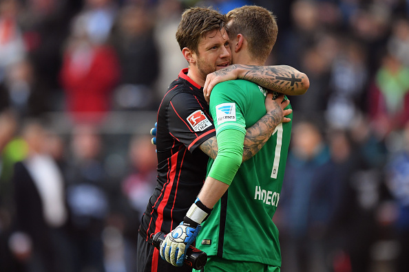FRANKFURT AM MAIN, GERMANY - APRIL 24: Marco Russ of Frankfurt hugs team mate Lukas Hradecky after the Bundesliga match between Eintracht Frankfurt and 1. FSV Mainz 05 at Commerzbank-Arena on April 24, 2016 in Frankfurt am Main, Germany.  (Photo by Matthias Hangst/Bongarts/Getty Images)