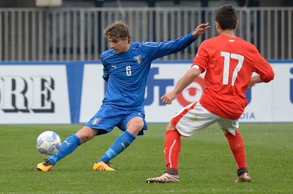 PADOVA, ITALY - MARCH 27:  Manuel Locatelli (L) of Italy U19 competes with Arxhend Cani of Switzerland U19 during the UEFA European U19 Championship Elite Round match between Italy and Switzerland at Stadio Euganeo on March 27, 2016 in Padova, Italy.  (Photo by Dino Panato/Getty Images)