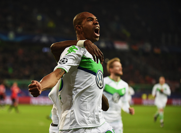 of Wolfsburg is challenged by of Manchester during the UEFA Champions League match between VfL Wolfsburg and Manchester United FC at the Volkswagen arena on December 8, 2015 in Wolfsburg, Germany.