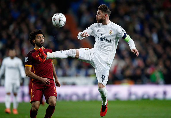 MADRID, SPAIN - MARCH 08:  Sergio Ramos of Real Madrid wins posession over Mohamed Salah of Roma during the UEFA Champions League Round of 16 Second Leg match between Real Madrid and Roma at Estadio Santiago Bernabeu on March 8, 2016 in Madrid, Spain.  (Photo by Gonzalo Arroyo Moreno/Getty Images)