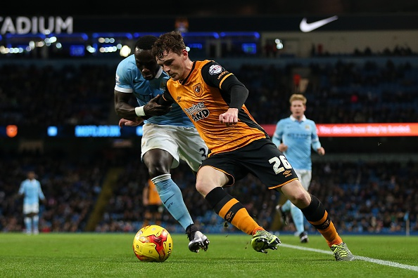 MANCHESTER, ENGLAND - DECEMBER 01: Bacary Sagna of Manchester City in action with Andrew Robertson of Hull City during the Capital One Cup Quarter Final match between Manchester City and Hull City at Etihad Stadium on December 1, 2015 in Manchester, England. (Photo by Chris Brunskill/Getty Images)