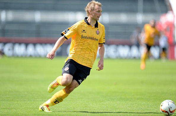 WUERZBURG, GERMANY - AUGUST 01: Tim Vaeyrynen of Dresden runs for the ball during the Third League match between Wuerzburger Kickers and Dynamo Dresden at flyeralarm Arena on August 1, 2015 in Wuerzburg, Germany.  (Photo by Micha Will/Bongarts/Getty Images)