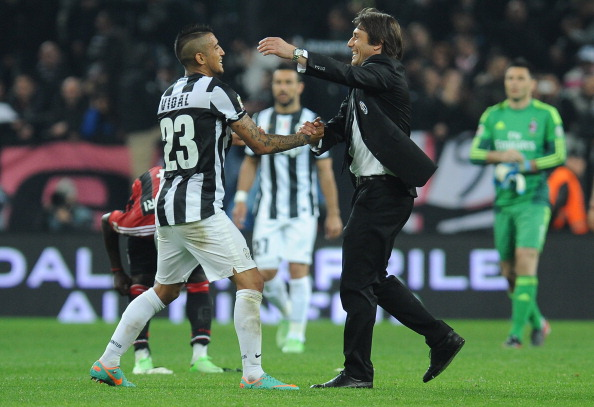TURIN, ITALY - APRIL 21:  Juventus FC head coach Antonio Conte (R) and Arturo Vidal celebrate victory at the end of the Serie A match Juventus FC v AC Milan at Juventus Arena on April 21, 2013 in Turin, Italy.  (Photo by Valerio Pennicino/Getty Images)