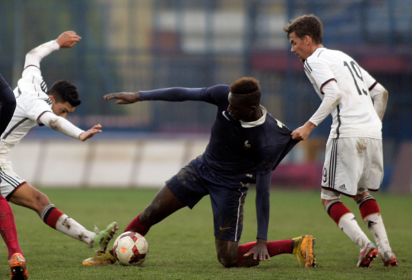 VERIA, GREECE - NOVEMBER 17:Marco Hingerl (R) and Nadiem Amiri of Germany competes with Sehrou Guirassy of France during the UEFA U-19 Friendly Tournament match between  France vs Germany at  Stadium Veria  on  November 17, 2014 in Veria, Greece  (Photo by Milos Bicanski/Getty Images) *** Local Caption***