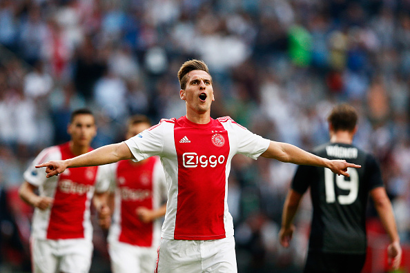 AMSTERDAM, NETHERLANDS - AUGUST 20:  Arkadiusz Milik of Ajax celebrates scoring his teams first goal of the game from the penalty spot during the UEFA Europa League play off round 1st leg match between Ajax Amsterdam and FK Baumit Jablonec on August 20, 2015 in Amsterdam, Netherlands.  (Photo by Dean Mouhtaropoulos/Getty Images)