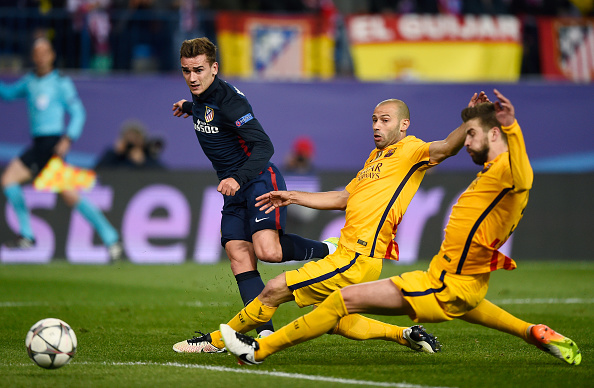 MADRID, SPAIN - APRIL 13:  Antoine Griezmann of Atletico Madrid shoots as he is challenged by Javier Mascherano of Barcelona during the UEFA Champions League quarter final, second leg match between Club Atletico de Madrid and FC Barcelona at the Vincente Calderon on April 13, 2016 in Madrid, Spain.  (Photo by Mike Hewitt/Getty Images)