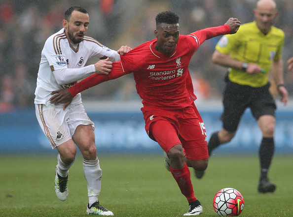 SWANSEA, WALES - MAY 01: Daniel Sturridge of Liverpool is challenged by Leon Britton of Swansea City during the Barclays Premier League match between Swansea City and Liverpool at The Liberty Stadium on May 1, 2016 in Swansea, Wales.  (Photo by Steve Bardens/Getty Images)