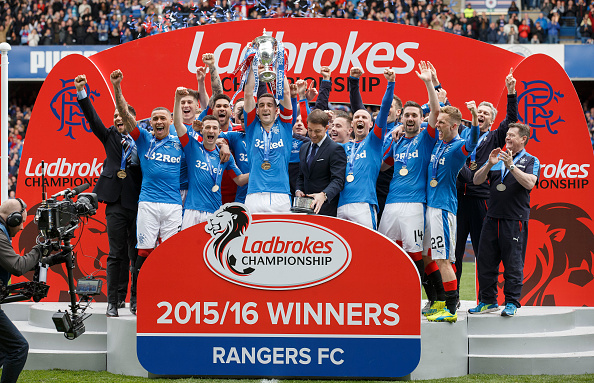 GLASGOW, SCOTLAND - APRIL 23: Rangers captain Lee Wallace lifts the Scottish Championship Trophy at Ibrox Stadium on April 23, 2016 in Glasgow, United Kingdom. (Photo by Steve Welsh/Getty Images)