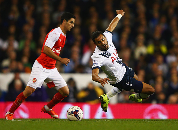 LONDON, ENGLAND - SEPTEMBER 23:  Nacer Chadli of Tottenham Hotspur battles with Mikel Arteta of Arsenal during the Capital One Cup third round match between Tottenham Hotspur and Arsenal at White Hart Lane on September 23, 2015 in London, England.  (Photo by Ian Walton/Getty Images)