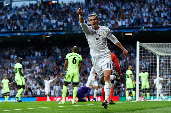 MADRID, SPAIN - MAY 04:  Gareth Bale of Real Madrid celebrates scoring the opening goal during the UEFA Champions League semi final, second leg match between Real Madrid and Manchester City FC at Estadio Santiago Bernabeu on May 4, 2016 in Madrid, Spain.  (Photo by David Ramos/Getty Images )