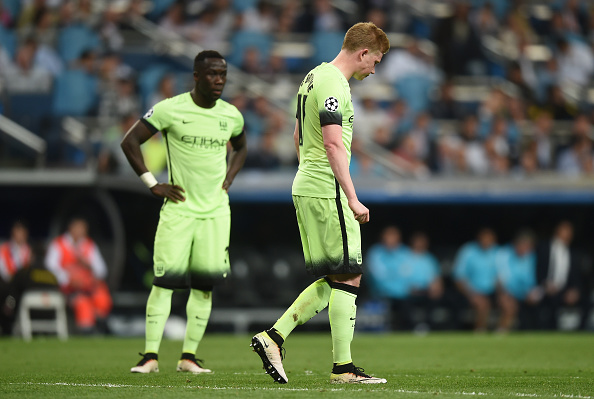 MADRID, ENGLAND - MAY 04:  Kevin de Bruyne of Manchester City and Bacary Sagna of Manchester City look on during the UEFA Champions League semi final, second leg match between Real Madrid and Manchester City FC at Estadio Santiago Bernabeu on May 4, 2016 in Madrid, Spain.  (Photo by Michael Regan/Getty Images)