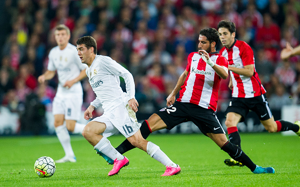 BILBAO, SPAIN - SEPTEMBER 23: Mateo Kovacic of Real Madrid CF duels for the ball with Raul Garcia of Athletic Club Bilbao during the La Liga match between Athletic Club Bilbao and Real Madrid CF at San Mames Stadium on September 23, 2015 in Bilbao, Spain.  (Photo by Juan Manuel Serrano Arce/Getty Images)